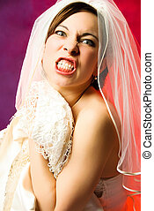 aggressive young bride - studio portrait of an aggressive...
