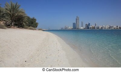 Beach and Abu Dhabi skyline, United Arab Emirates