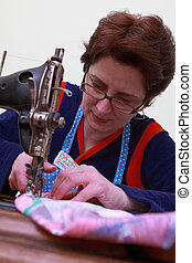 Seamstress - Close-up of a seamstress working with an old...