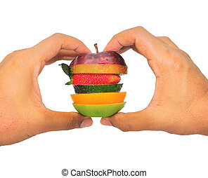 Two hands holding layer of fruits