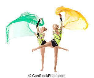 Two beauty acrobats dance with flying cloth