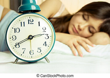 beautiful sleeping woman with an alarm clock - beautiful...