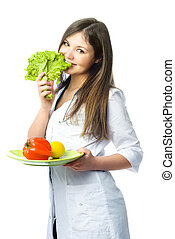 happy doctor with fresh vegetables - happy doctor dressed in...