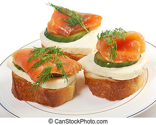 Canapes with smoked salmon cheese and cucumber - Canapes...