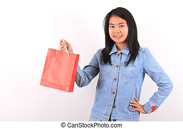 Happy shopping woman show her bags and smiling isolated over...