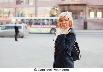 Young woman on the city street
