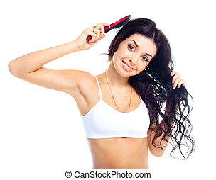 girl brushing her hair
