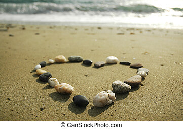 Heart made of stones on sand - Heart made of stones on a...