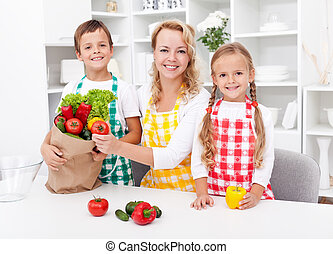 Unpacking the groceries - preparing a meal - Woman and kids...