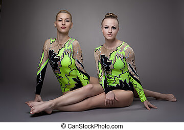 two Young beauty acrobats relax portrait