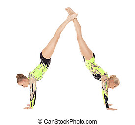 Two young acrobats woman stand on hands