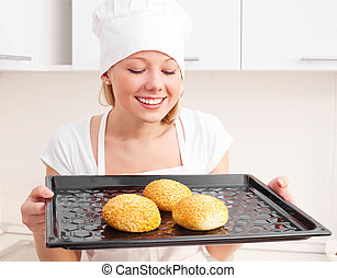 woman baking bread - beautiful young woman baking bread in...