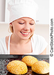 woman baking bread - pretty young woman baking bread in the...
