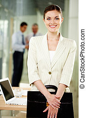 Happy employee - Smiling businesswoman with briefcase...