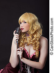Beautiful singer cosplay anime character - Young woman as...