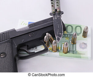 pistol - A pistol with a wad of 100 Euro bills, cartridges...