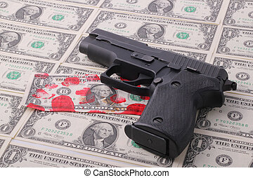 pistol - A pistol on one-dollar bills with a bloodstained...