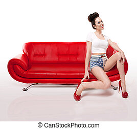 Retro Pin-up Girl On Red Leather Couch