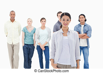 People behind a woman smiling against white background