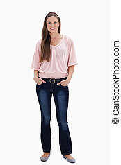 Woman smiling with her hands in her pockets