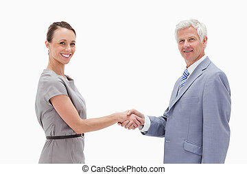 Close-up of a white hair man face to face and shaking hands...