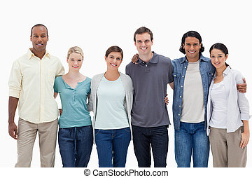 People smiling arms in arms against white background