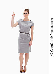 Woman posing in a dress showing something above with her...