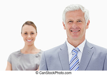 Close-up of a happy white hair businessman with a woman...