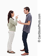 Woman scolding man against white background