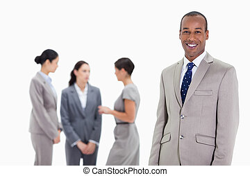 Businessman with co-workers talking in the background -...
