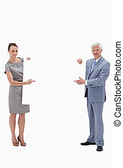 White hair businessman holding and pointing to a big white...
