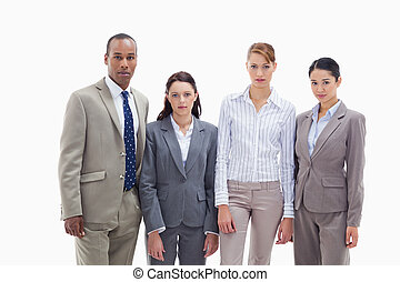 Serious business team side by side against white background