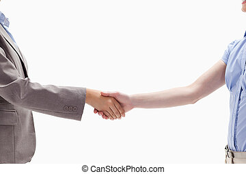 Handshake between two women against white background