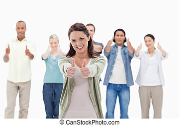 Close-up of people with their thumbs-up focus on the woman...