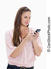 Close-up of a girl typing a text message against white...