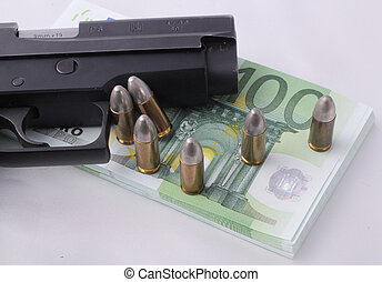 pistol - A pistol with a wad of 100 Euro bills and...