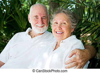 Senior Couple in the Tropics - Affectionate senior couple in...