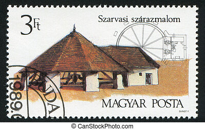Horse-Driven Mill - HUNGARY - CIRCA 1989: stamp printed by...