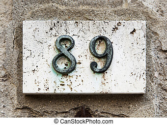 Block number on a wall - Block number on a weathered wall -...