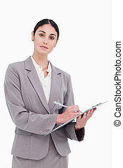 Businesswoman ready to take notes against a white background