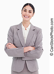 Smiling young saleswoman with arms crossed