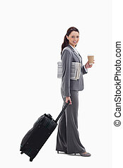 Profile of a businesswoman smiling going for a trip -...