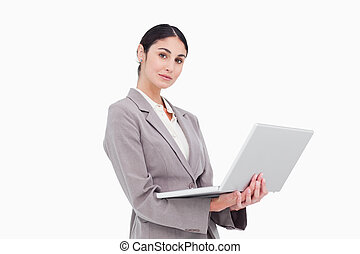 Side view of businesswoman with laptop