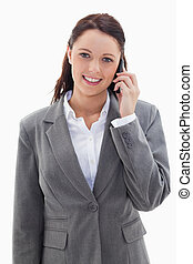 Businesswoman smiling over the phone against white...