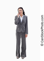 Businesswoman watching on the top speaking in a headset