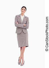 Smiling businesswoman with her arms crossed