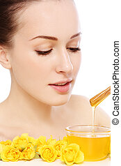 Organic beauty - Young beautiful healthy woman making honey...