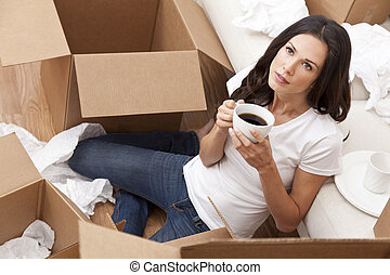 Woman Drinking Coffee Unpacking Boxes Moving House