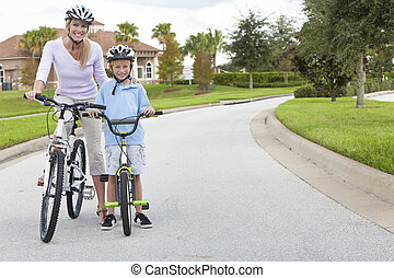 Woman and Boy Child, Mother and Son Cycling - A young family...