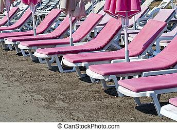 Pink sunbeds at beach